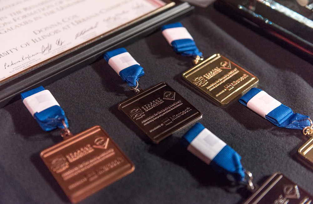 Gold, silver, and bronze medals, with blue ribbons.
